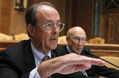 Erskine Bowles, left, accompanied by former Wyoming Sen. Alan Simpson, co-chairmen of President Obama's bipartisan deficit commission, gestures while speaking on Capitol Hill on Wednesday.