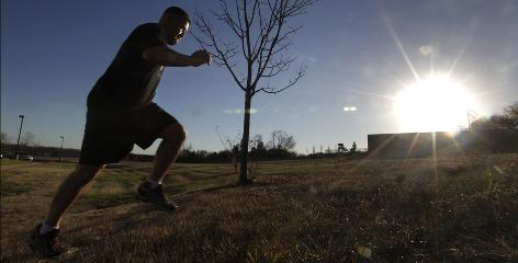 Brandon Bailey runs up a hill during his physical therapy session in Florence, Ohio.
