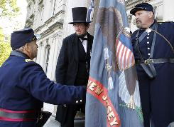 Civil War re-enactors, including Robert Costello as Abraham Lincoln, participate Oct. 25 in Trenton, N.J., in an early commemoration of the state's role in war.