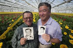 John Muller, left, and Steve Oku were both born on Jan. 1, 1946, making them among the first Baby Boomers to turn 65. Their mothers shared a hospital room in California.