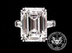 Photo from the U.S. Marshals Service shows a ladies diamond engagement ring, part of thousands of belongings from Bernard Madoff's New York penthouse on the auction block on Saturday. The ring sold for $550,000.