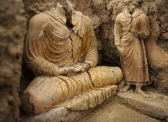 Ancient Buddha statues inside a temple in Mes Aynak, south of Kabul, Afghanistan. This archaeological site is located at the world's second-largest unexploited copper mine in Logar province.