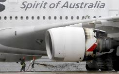 Firefighters surround a Qantas Airbus A380 after an emergency landing Nov. 4 in Singapore.