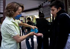 A Mexican student cleans hands with disinfectant gel as he arrives at the National Technical Institute in May 2009. A U.S. report says Mexico's H1N1 virus outbreak likely contributed to a 263% decline in U.S. students studying there.