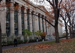 Students walk through the Harvard Law School area on the campus of Harvard University in Cambridge, Mass. Presidents of elite schools such as Harvard, Princeton and Johns Hopkins were all paid in the $800,000s, below the seven figures club.