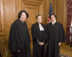 Justice Elena Kagan, right, with Justices Sonia Sotomayor, left, and Ruth Bader Ginsburg, has written no opinions and has cast few votes in her first term. Her presence has been felt primarily in the argument sessions held since the court began a new term Oct. 4.