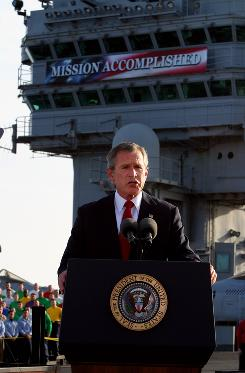 "President Bush declares the end of major combat in Iraq on May 1, 2003, as he speaks aboard the aircraft carrier USS Abraham Lincoln off the California coast. The ""Mission Accomplished"" banner in the background is now in storage and will become a part of his presidential library's collection."