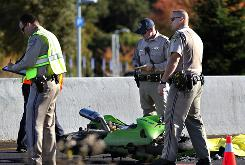 Officers investigate a fatal motorcycle accident Monday on Hwy 101 in Santa Rosa, Calif. The NTSB is urging states to make helmets mandatory for all riders.