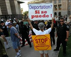 Supporters and opponents of Arizona's immigration enforcement law face off during a demonstration against illegal immigration on July 31 in Phoenix.