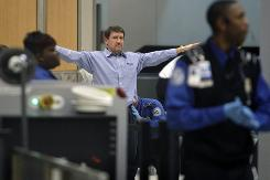 A passenger is patted down while going through a security checkpoint at Hartsfield-Jackson Atlanta International Airport on Wednesday.