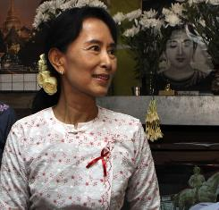 Burma's democracy leader Aung San Suu Kyi visits a shelter for HIV/AIDS patients on the outskirts of Yangon on Wednesday.