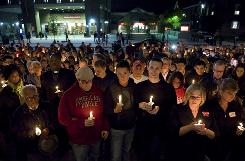 People participate in a candlelight vigil Oct. 3 for Rutgers University freshman Tyler Clementi on the Rutgers campus in New Brunswick, N.J.