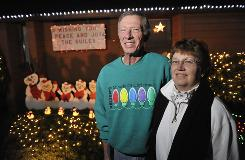 Dave and Norma Guile, at their home in Keizer, Ore., in 2009, helped found the Miracle of Christmas lights display in 1984.