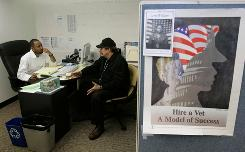 Walter Williams, left, case manager for Swords to Plowshares, counsels Vietnam war veteran Mark Ridgely in the center's offices in San Francisco in 2008. The group has provided free lawyers to veterans denied benefits.