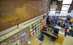 A frieze by Ethel Spears adorns Angela Hondropoulos' kindergarten class at Nettelhorst Elementary School in Chicago. It's one of two restored Works Progress Administration pieces on display at the school.