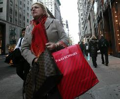 A shopper walks down Fifth Avenue this weekend in New York City as the holiday shopping season kicks off.