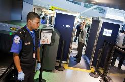 TSA officers demonstrate advanced scanner technology at JFK Airport in New York. The powerful scanners and more invasive pat-downs have come under fire recently.