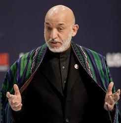 Afghan President Hamid Karzai answers a question during a news conference at the NATO summit in Portugal on Saturday.