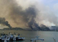 Smoke billows from Yeonpyeong island near the border against North Korea, in South Korea, on Tuesday. North Korea shot dozens of rounds of artillery onto the populated South Korean island near their disputed western border, military officials said.