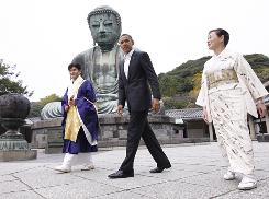 President Obama visits the Great Buddha of Kamakura with Michiko Sato, temple director, and Takao Sato, the 15th Chief Monk of the temple, at Kotoku-in Temple in Kamakura, Japan, on Nov. 14.