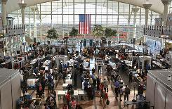 Passengers move through a main security checkpoint at the Denver International Airport on Monday. Loose-knit groups on the Internet are urging travelers to boycott the body scanners at airports Wednesday, which would force the TSA to perform more of the time-consuming pat-downs than normal.
