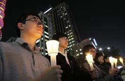 South Koreans take a moment of silence for South Korean marines killed in a North Korean bombardment during a rally against North Korea's attack onto South Korean island, in Seoul.