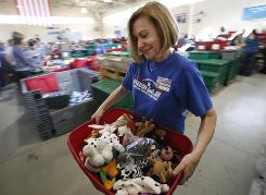 Kathleen Vincent hauls a load of Beanie Babies to the assembly line. Troops like to give the stuffed animals to children they encounter in Iraq and Afghanistan.