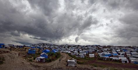 A camp for people displaced by the January earthquake sits beneath a dark and cloudy sky Nov. 5 in Port-au-Prince, Haiti, as Hurricane Tomas passed most of the island nation.