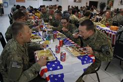 U.S. troops take their lunch during Thanksgiving Day at the U.S. base in Bagram, north of Kabul, Afghanistan.