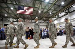 Members of the Iowa Army National Guard who will be deployed to Iraq march in front of family and friends this week at a sendoff ceremony.