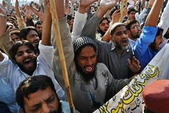 Pakistani Islamists chant slogans against Asia Bibi, a Christian mother sentenced to death, during a protest in Lahore on Friday. Officials announced they had broken up a terrorist plot.