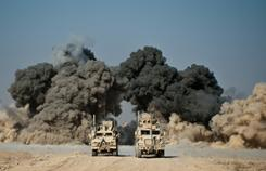 U.S. soldiers blow up a wall of a compound near Kandahar city on Monday..