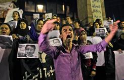 """Protesters chant """"Fraud"""" as they make a demonstration of about 100 opposition activists in downtown Cairo, Monday."""