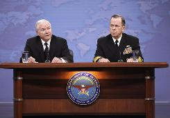 Defense Secretary Robert Gates, left, and Joint Chiefs Chairman Adm. Mike Mullen speak to reporters about gays in the military at the Pentagon on Tuesday.