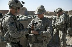 U.S. soldiers of the 502nd Infantry regiment 2nd Batallion Charger company 1st platoon load their weapons at a camp near Kandahar, Afghanistan on Nov. 28.