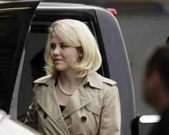 Elizabeth Smart is escorted into Frank Moss Federal Courthouse in Salt Lake City to testify in the Brian David Mitchell trial on Nov. 10.