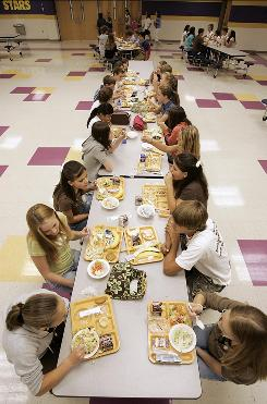 Students eat lunch at Pleasant View Middle School in Springfield, Tenn.