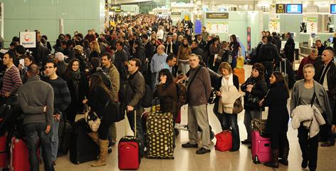 Passengers wait for news about their flights at El Prat Llobregat airport, near Barcelona, on Friday. Spain's air traffic authority closed several airports including Madrid's international hub due to a lack of air traffic controllers.