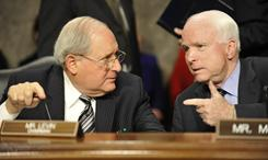 Sen. John McCain, R-Ariz., right, confers with Senate Armed Services Committee colleague and chairman Sen. Carl Levin, D-Mich., on Thursday.