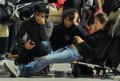 Passengers wait as Barajas airport is crippled by a sudden strike, Friday, in Madrid. A massive walk out by air traffic controllers on the eve of a bank holiday has caused problems all over Spain.