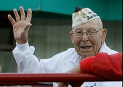 Clarence Lux Clarence Lux of Yucca Valley, Calif., a Pearl Harbor survivor, waves to the crowd at the 2010 Palm Springs Veterans Day Parade on Nov. 11.