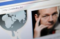 The homepage of Wikileaks.ch with a picture of its founder Julian Assange is seen on a computer screen on Saturday. PayPal axed donations access for the whistleblowing website.