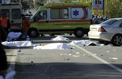 Four bodies of bicycle riders lie on the road following an accident in Lamezia Terme, southern Italy, on Sunday.