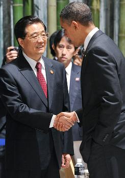 President Obama greets Chinese President Hu Jintao during The Asia Pacific Economic Cooperation summit in Yokohama, Japan, on November 14.