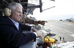 Defense Secretary Robert Gates watches flight operations aboard the USS Abraham Lincoln in the Arabian Sea on Monday.