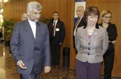 EU foreign policy chief Catherine Ashton right, greets Saeed Jalili, Iran's chief negotiator in a conference center in Geneva, Switzerland to discuss calls to curb Iran's nuclear activities.