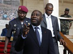 Incumbent President Laurent Gbagbo, who the U.N. says lost Ivory Coast's presidential election, gestures as he walks between meetings ahead of naming his new Cabinet in Abidjan on Tuesday.