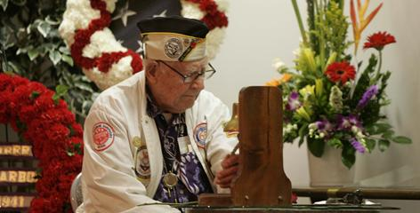  John Morrill of the Pearl Harbor Survivors Association rings a bell in a June memorial in San Diego. The association's membership numbers are so low that the possibility of disbanding it has been discussed.