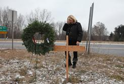 Marcia DiNatale visits a memorial for her husband at the site where he died Oct. 31, after his car was struck by a man accused of drunken driving. That man is free on a $5,000 bond.