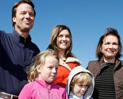 John Edwards waves to the crowd with his daughters Cate, center, and Emma Claire, left, son Jack and wife Elizabeth after announcing that he is withdrawing from the 2008 presidential race on Jan. 30, 2008 in New Orleans.